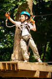 Five year boy on rope-way in forest Stock Image