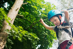 Five year boy on rope-way in forest Stock Photography