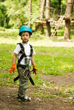 Five year boy on rope-way in forest Royalty Free Stock Photography