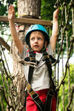 Five year boy on rope-way in forest Stock Images