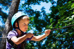 Five year boy on rope-way in forest Royalty Free Stock Photos