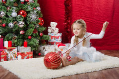 Five-year girl with balloons near Christmas tree Stock Images
