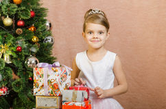 Five-year girl with Christmas gifts at the Christmas tree Stock Images