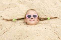Five-year girl with glasses on the beach Stock Photography