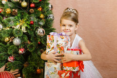 Five-year girl hugs Christmas gifts Royalty Free Stock Photo
