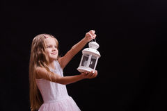 Five-year girl shines candlestick into the distance Royalty Free Stock Image