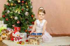 Five-year girl with small gifts in lid of the box Royalty Free Stock Photos