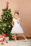 Five-year girl is standing at the Christmas tree Royalty Free Stock Photo