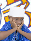"""Five-year-old Afro boy wearing a blue """"boubou"""" and a white hat Royalty Free Stock Image"""