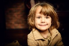 Five year old boy. Close-up portrait of a pretty five year old boy at home in a vintage style. Childhood royalty free stock images