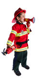 Five year old boy in a suit firefighter says in speaker Royalty Free Stock Photos