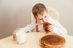 Five year old child to eat pancakes royalty free stock photography