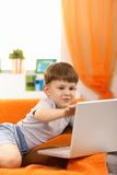 Five year old with computer Royalty Free Stock Photos