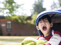 Five year old disabled boy going to school Stock Photos