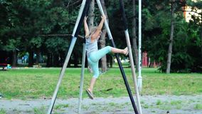 Little girl is climbing on basketball  poles and jumping down. Five year old girl is climbing on basketball  poles and jumping down stock video