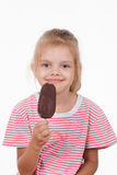Five year old girl with ice cream. Five year old girl having fun eating ice cream popsicle Stock Images