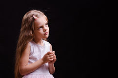 Five year old girl is waiting for the fulfillment of dreams Royalty Free Stock Photo