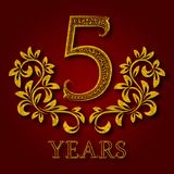 Five years anniversary celebration patterned logotype. 5th anniversary vintage golden logo. With shadow Stock Photos