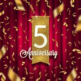 Five years anniversary golden signboard in spotlight on red curtain background and golden confetti. Royalty Free Stock Image