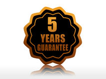 Five years guarantee starlike label. Five years guarantee - golden starlike label with text Royalty Free Stock Image