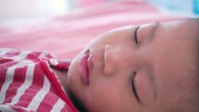 Boy sleeping on bed stock footage