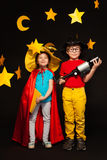 Five years old boy and girl playing sky watchers. Full length photo of five years old boy and girl, playing sky watchers with a telescope, standing among Stock Images
