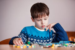 Five years old boy playing with building blocks Royalty Free Stock Image