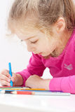 Five years old caucasian blond child girl drawing picture Stock Photography
