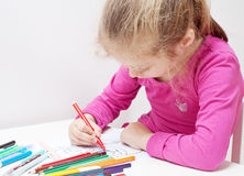 Five years old caucasian blond child girl drawing picture Stock Images