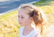 Five years old caucasian child girl standing by the road. Portrait of five years old blond caucasian child girl standing outdoor by the road at sunset royalty free stock photography