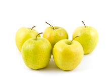 Five yellow apples. On white stock image