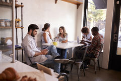 Free Five Young Adults Hanging Out At A Coffee Shop Stock Photo - 85183000
