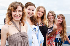 Five young beautiful women in line. Five young beautiful females are standing in line. Caucasian people. Summer time Royalty Free Stock Images
