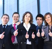 Five young business persons in formal clothes Stock Photos