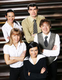 Five young businesspersons on a staircase Royalty Free Stock Photos