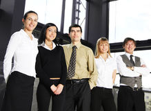 Five young businesspersons are standing in a row Royalty Free Stock Photography
