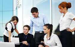 Five young businesspersons are working together Stock Photo