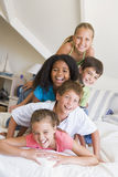 Five Young Friends Lying On Top Of Each Other Royalty Free Stock Photo