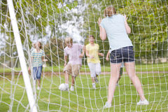 Five young friends playing soccer Stock Photo