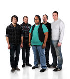 Five Young Men. Group of five young men standing over a white background Royalty Free Stock Photo