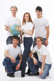Five young people with a globe Stock Images