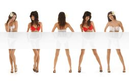 Five young and sexy brunette girls with a poster Royalty Free Stock Image