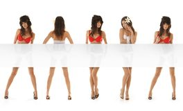Five young and sexy women with a blank poster Royalty Free Stock Photos