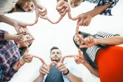 Five young smiling people make star shape from fingers. Five young smiling women and men make star shape from fingers. Happy friends or students show a sign with Stock Photos
