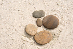 Five zen stones with copy space lying on the beach Stock Photography