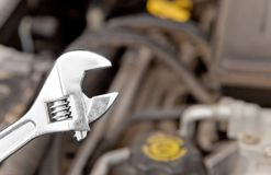 Fix it. A wrench in front of a motor Stock Image