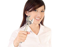 Fix. Businesswoman holding wrench to fix on white background stock image
