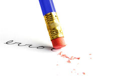 Fix it. Pencil erasing an error, on white Royalty Free Stock Image