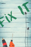 Fix it against tools on wooden background Stock Image