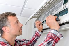 Fix this air conditioning. Activity royalty free stock photos